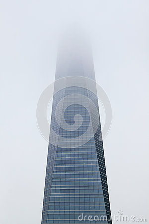 Skyscraper day in a haze of fog.