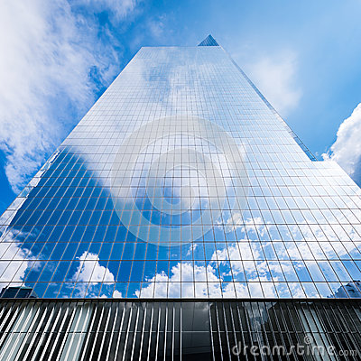 Free Skyscraper Reflecting Blue Sky And White Clouds Royalty Free Stock Photos - 61341898