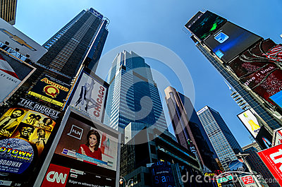 Skyscrapers, Billboards and Signs of Times Square along Broadway Editorial Photo