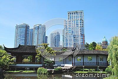 Skyscrapers over look Chinese garden,