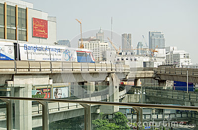 Skytrain travelling over Siam Square Editorial Stock Image