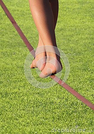 Slackline feet over grass