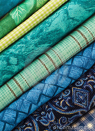 Slanted Stack of Blue and Green Fabrics