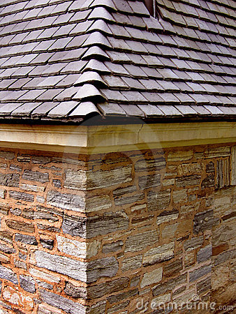Slate roof with stone wall