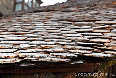 Slate stone roof tiles perspective selective focus