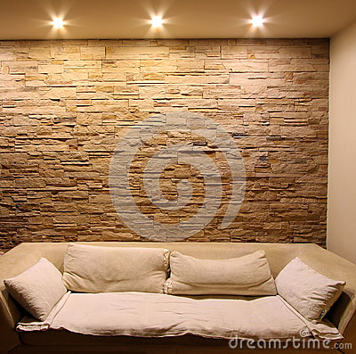 Slate stone wall with couch