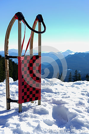 Sled in snow at mountains