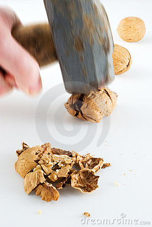 Free Sledgehammer To Crack Nuts Royalty Free Stock Photos - 4977238