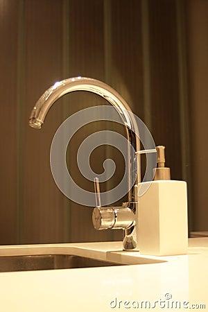 Sleek kitchen faucet.