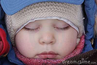 Sleep of child in winter clothes