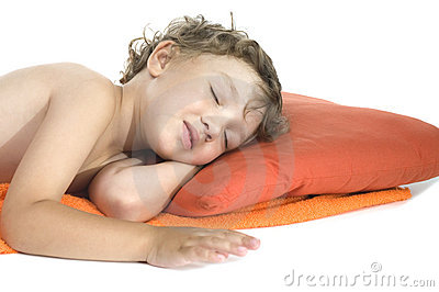 Sleep little boy on white