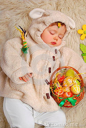 Sleeping baby girl as easter sheep