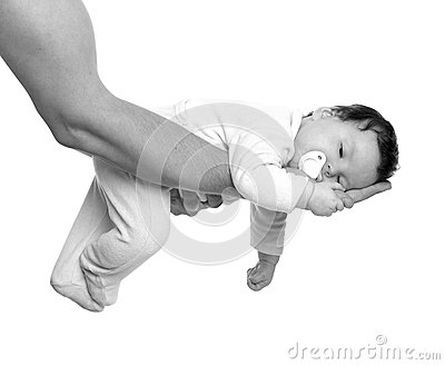 Almost sleeping baby girl in father arms on white