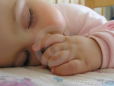 Sleeping baby with hand 2