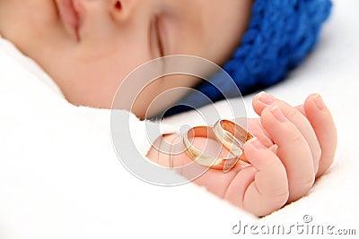 Sleeping baby with wedding rings