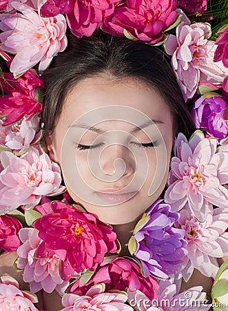 Sleeping Beauty: pretty woman among pink lilies