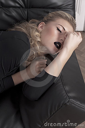 Sleeping blonde girl laying on a couch