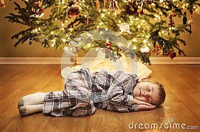 Sleeping boy waiting for Santa