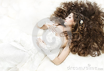 Sleeping bride with long curly hair lying down