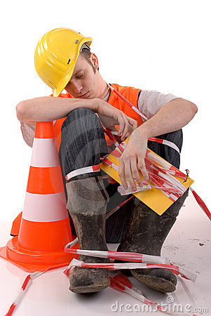Sleeping builder with safety cone.