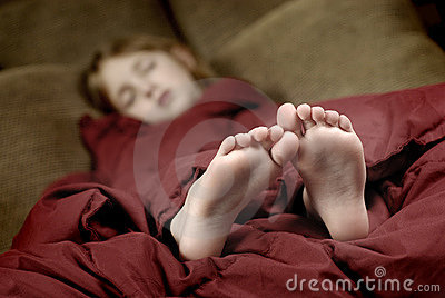 sleeping girls feet stiking out