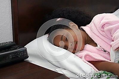 Sleeping girl in bed