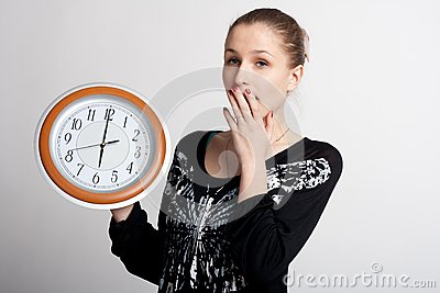 Sleeping girl with a big clock in his hands