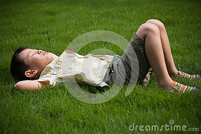 Sleeping on the grass boy
