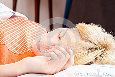 Sleeping with hand on pillow