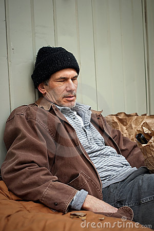 Sleeping Homeless Man with Wine Bottle in a Sack