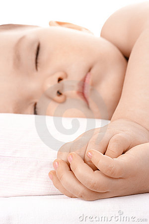 Sleeping little child, clasping his hands together