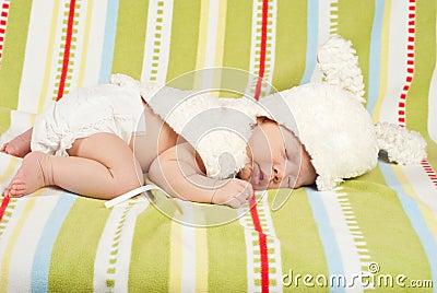 Sleeping little Easter newborn baby