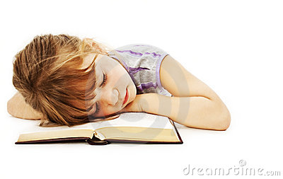 Sleeping little girl with book