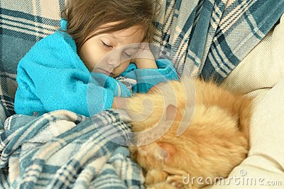Sleeping little girl with red cat Stock Photo