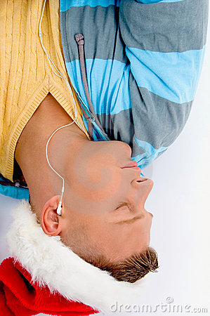 Sleeping man with christmas hat and ear phones