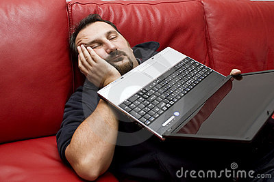 Sleeping man holding laptop