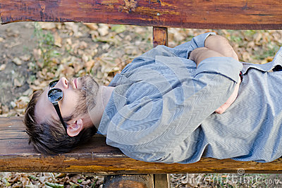 Sleeping man with sunglasses