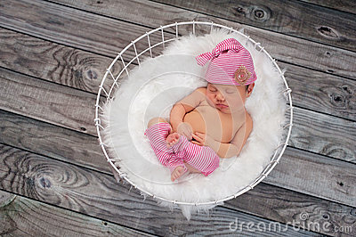 Sleeping Newborn Baby Girl Wearing Pink Sleeping Cap