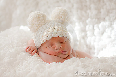 Sleeping newborn baby in knitted cap