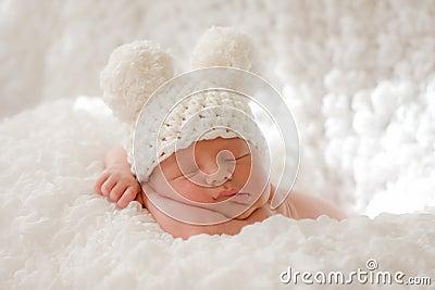 Sleeping newborn baby in knitted cap