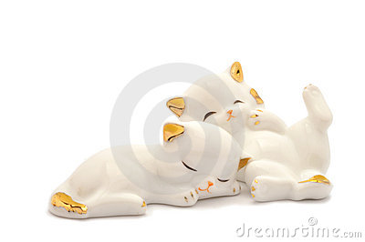 Sleeping porcelain cats