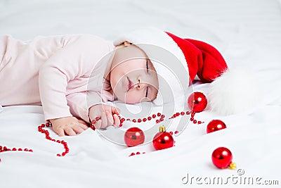Sleeping sweet baby girl Santa Claus