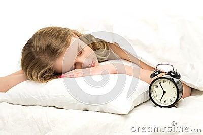 Sleeping woman with alarm clock