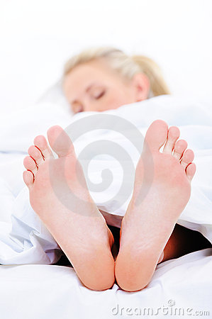 Sleeping woman with a clean  feets on foreground