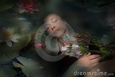Sleeping woman in a dark water of a river