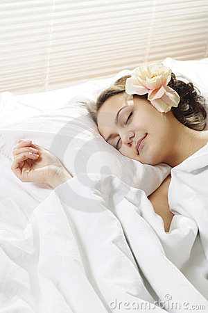Sleeping Woman in the morning in bed