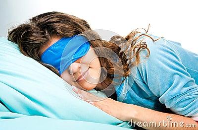 Sleeping Young Woman In Sleep Eye Mask