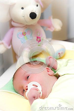 Sleepy baby girl in crib