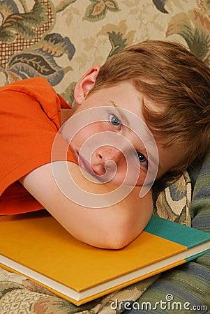 Sleepy boy doing homework