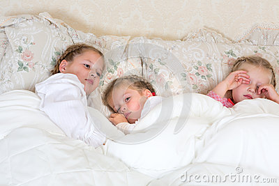 Sleepy girls in bed